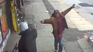 Saheed Vassell points a metal pipe at a pedestrian in Brooklyn April 4, 2018, in a still image from surveillance video released by the New York Police Department in New York City, New York, U.S. on April 5, 2018. NYPD/Handout via REUTERS