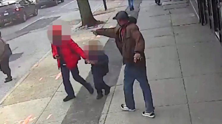 Saheed Vassell points a metal pipe at a pedestrian in Brooklyn April 4, 2018, in a still image from surveillance video released by the New York Police Department in New York City, New York, U.S. on April 5, 2018. Images of some faces have been obscured at source. NYPD/Handout via REUTERS