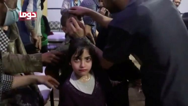 A girl looks on following alleged chemical weapons attack, in what is said to be Douma, Syria in this still image from video obtained by Reuters on April 8, 2018. White Helmets/Reuters TV via REUTERS