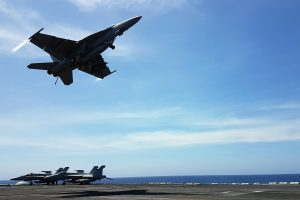 An F18 fighter takes off from the deck of the USS Theodore Roosevelt while transiting the South China Sea April 10, 2018. REUTERS/Karen Lema