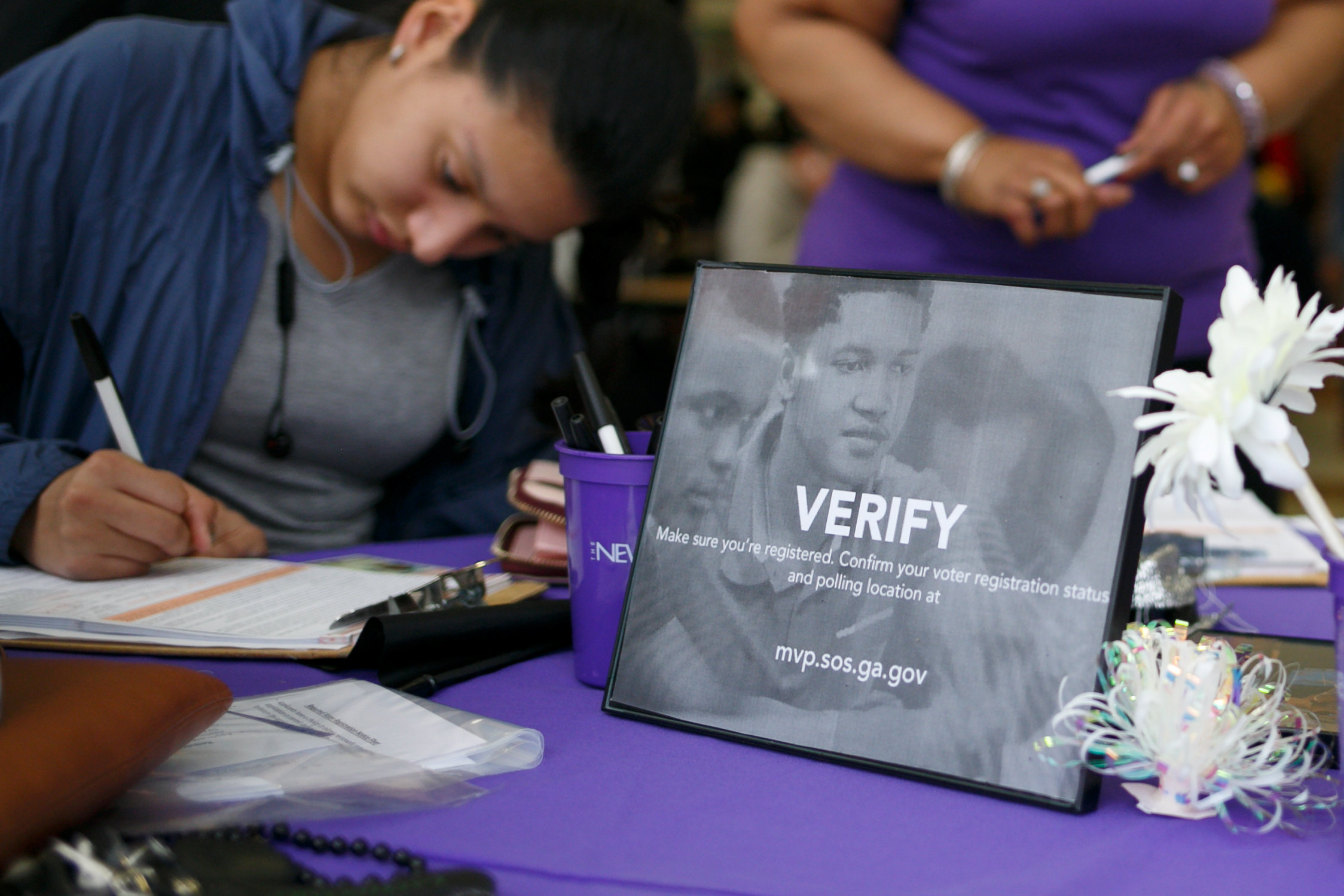 FILE PHOTO: South Cobb High School senior Fabiola Diaz, 18, carefully double-checks the details on her driver's license as she registers to vote during a registration drive by voting rights group New Project Georgia in Austell, Georgia, U.S. February 6, 2018. Picture taken February 6, 2018. REUTERS/Chris Aluka Berry