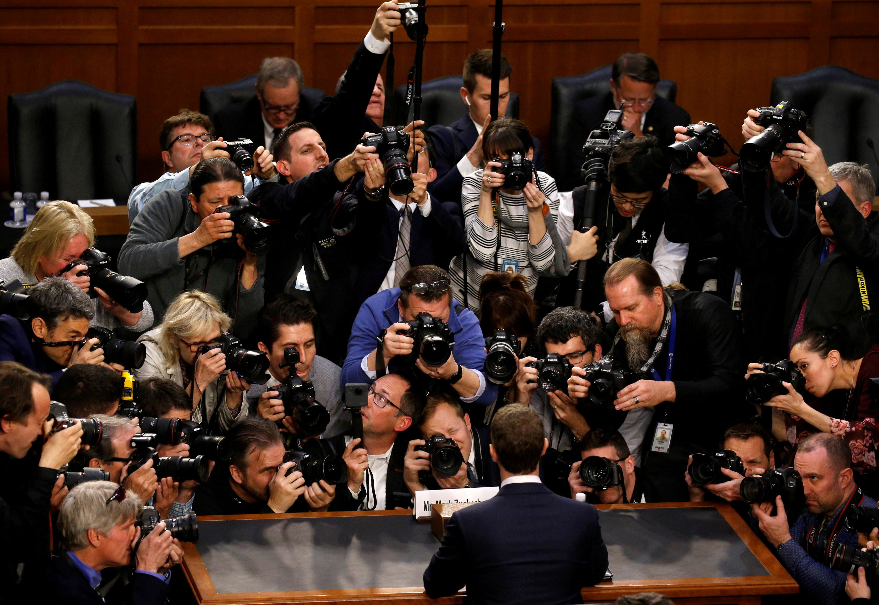 Facebook CEO Mark Zuckerberg is surrounded by members of the media as he arrives to testify before a Senate Judiciary and Commerce Committees joint hearing regarding the company's use and protection of user data, on Capitol Hill in Washington, U.S., April 10, 2018. REUTERS/Leah Milli