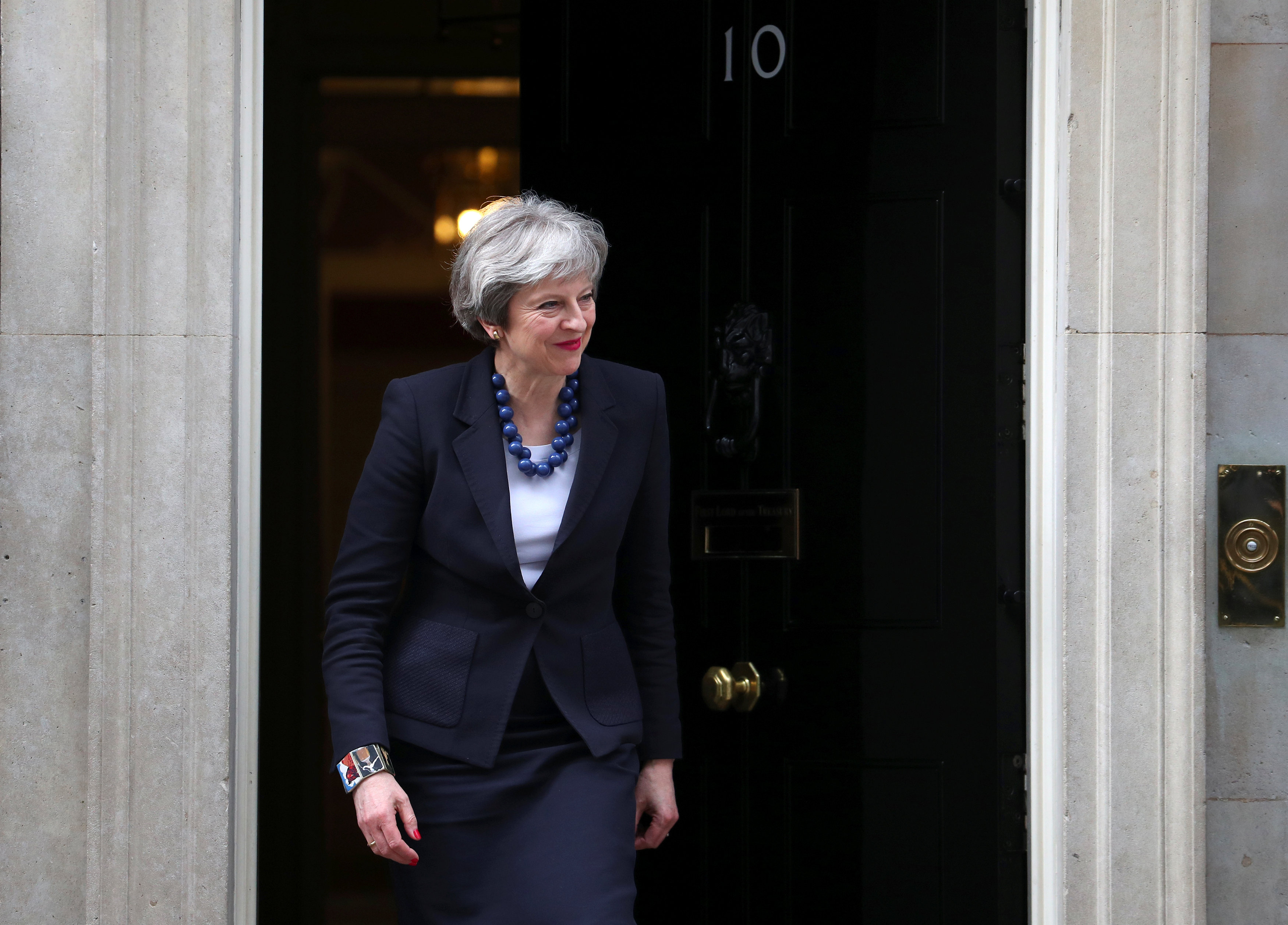 Britain's Prime Minister Theresa May walks out of 10 Downing Street to greet Portugal's Prime Minister Antonio Costa in London, April 10, 2018. REUTERS/Hannah Mckay