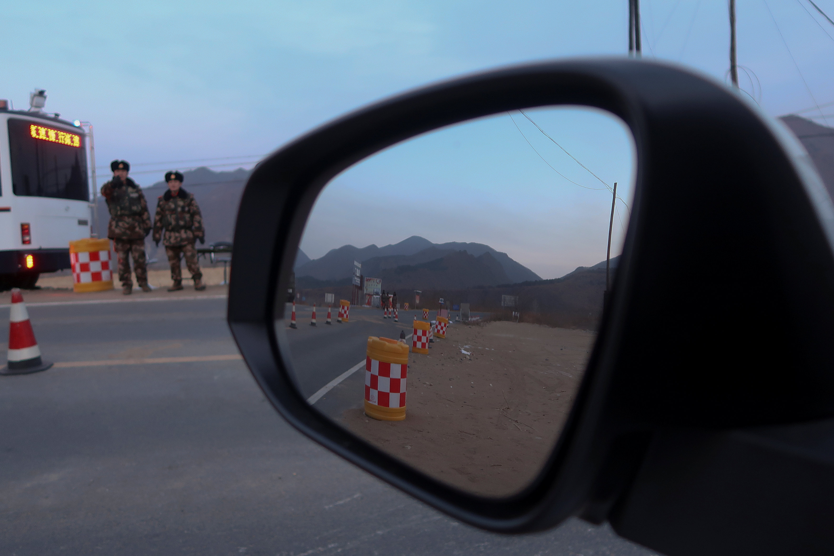 Policemen control a check point after preventing Reuters reporters from driving through, near the border of China and North Korea, just outside the village of Sanhe, China, November 25, 2017. REUTERS/Damir Sagolj
