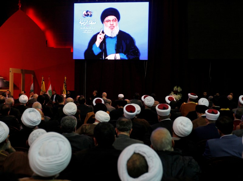 FILE PHOTO:Lebanon's Hezbollah leader Sayyed Hassan Nasrallah is seen on a video screen as he addresses his supporters in Beirut, Lebanon February 16, 2018. REUTERS/Aziz Taher/File Photo