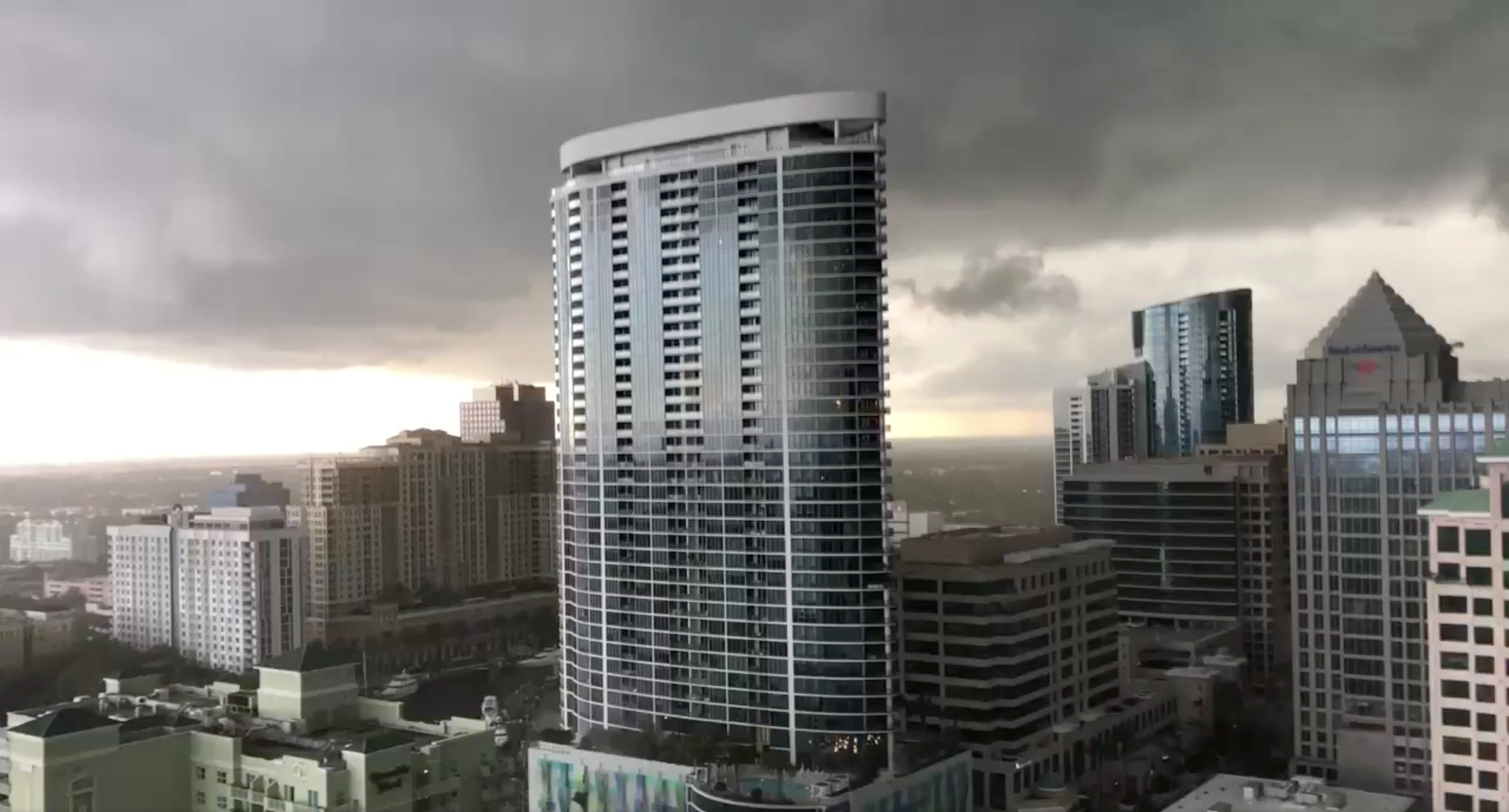 Dark clouds hover above buildings amidst tornadoes in Fort Lauderdale, Florida, the U.S., April 10, 2018 in this still image obtained from a social media video. Emmet Finneran/via REUTERS