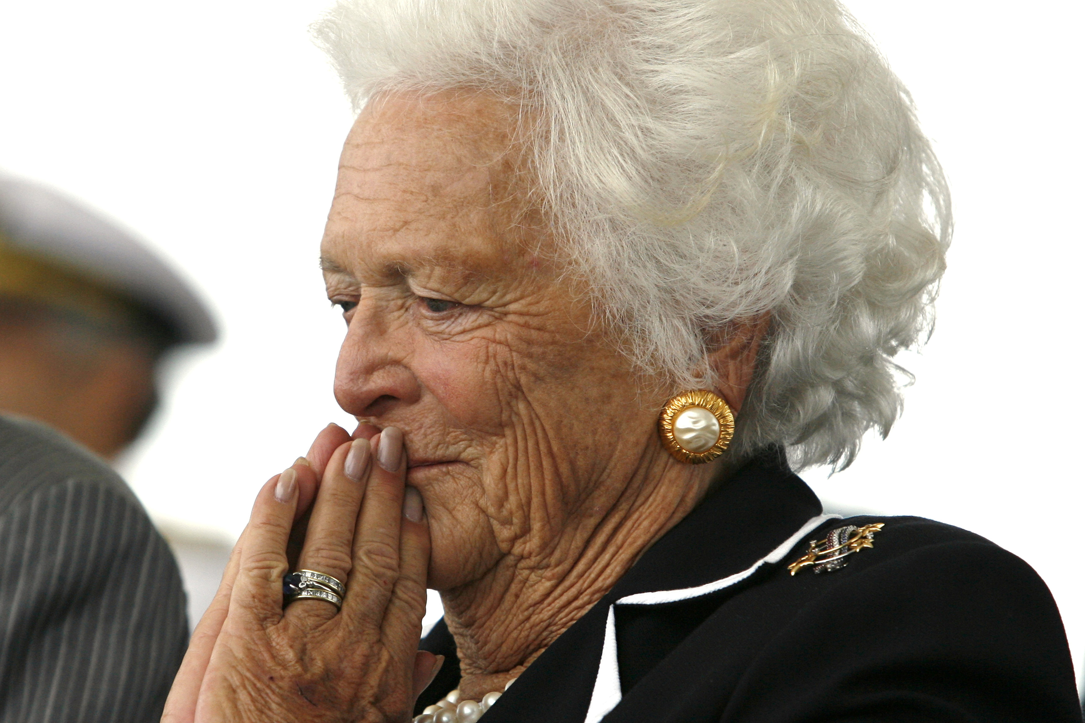 FILE PHOTO: Former first lady Barbara Bush listens to remarks during the christening ceremony of the USS George H.W. Bush at Northrop-Grumman's shipyard in Newport News, Virginia, U.S., October 7, 2006. REUTERS/Kevin Lamarque/File Photo