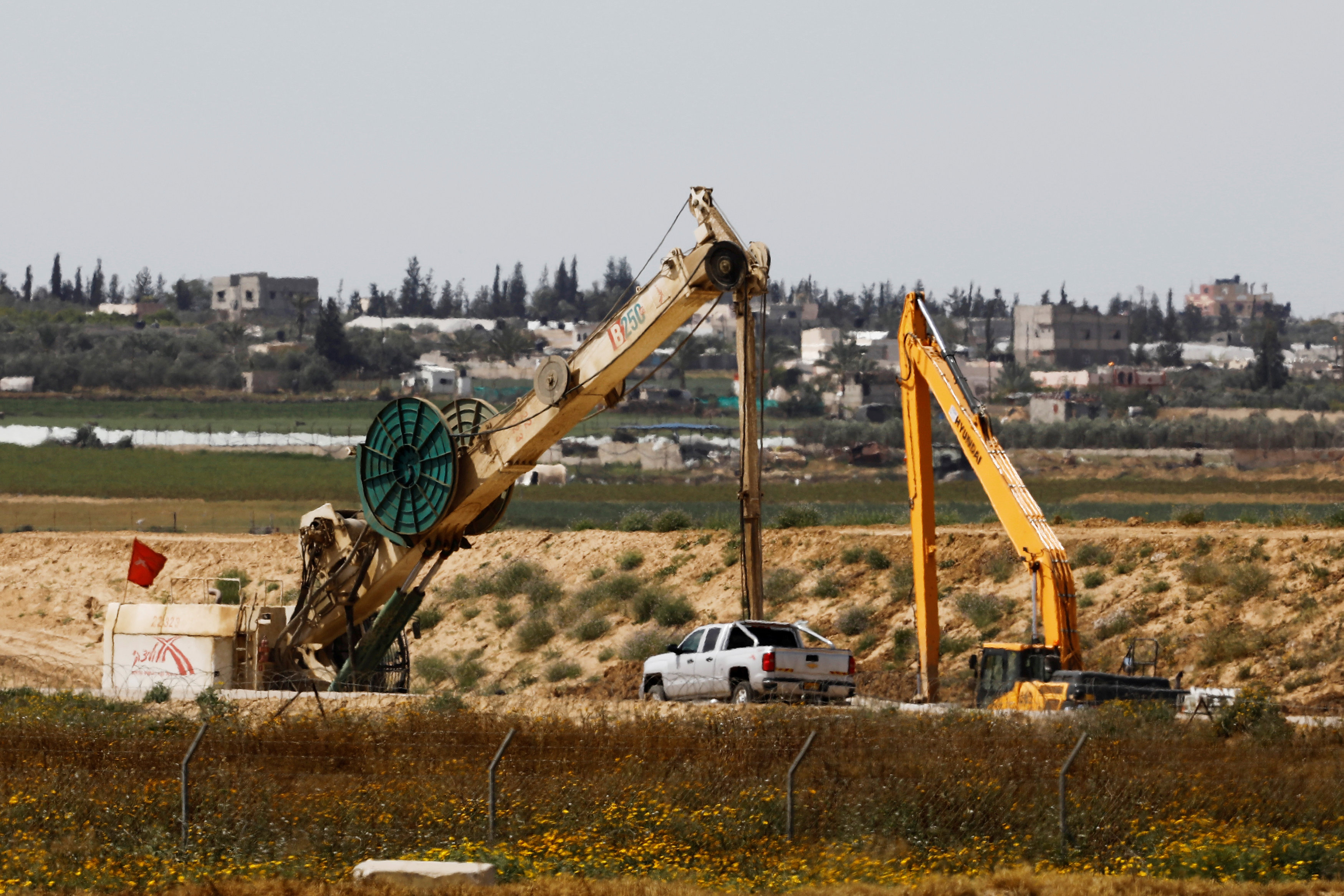 FILE PHOTO: Construction work can be seen on the Israeli side of the border between Israel and the Gaza Strip, Israel March 18, 2018. REUTERS/Amir Cohen/File Photo
