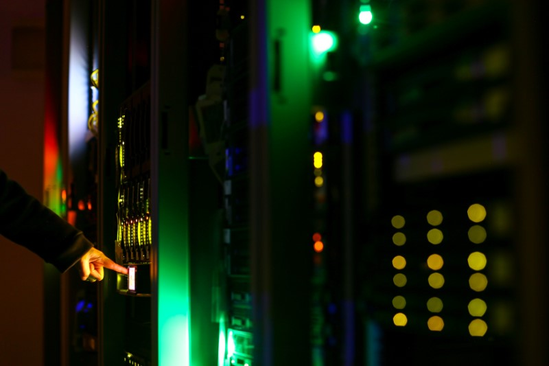A man poses inside a server room at an IT company in this June 19, 2017 illustration photo. REUTERS/Athit Perawongmetha/Illustration