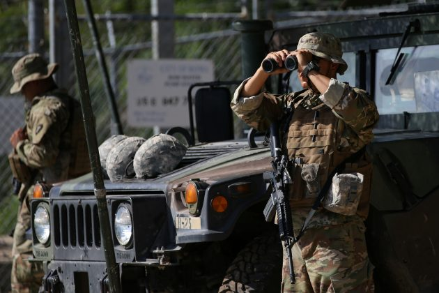 FILE PHOTO: Members of the Texas National Guard watch the Mexico-U.S. border from an outpost along the Rio Grande in Roma, Texas, U.S., April 11, 2018. REUTERS/Loren Elliott