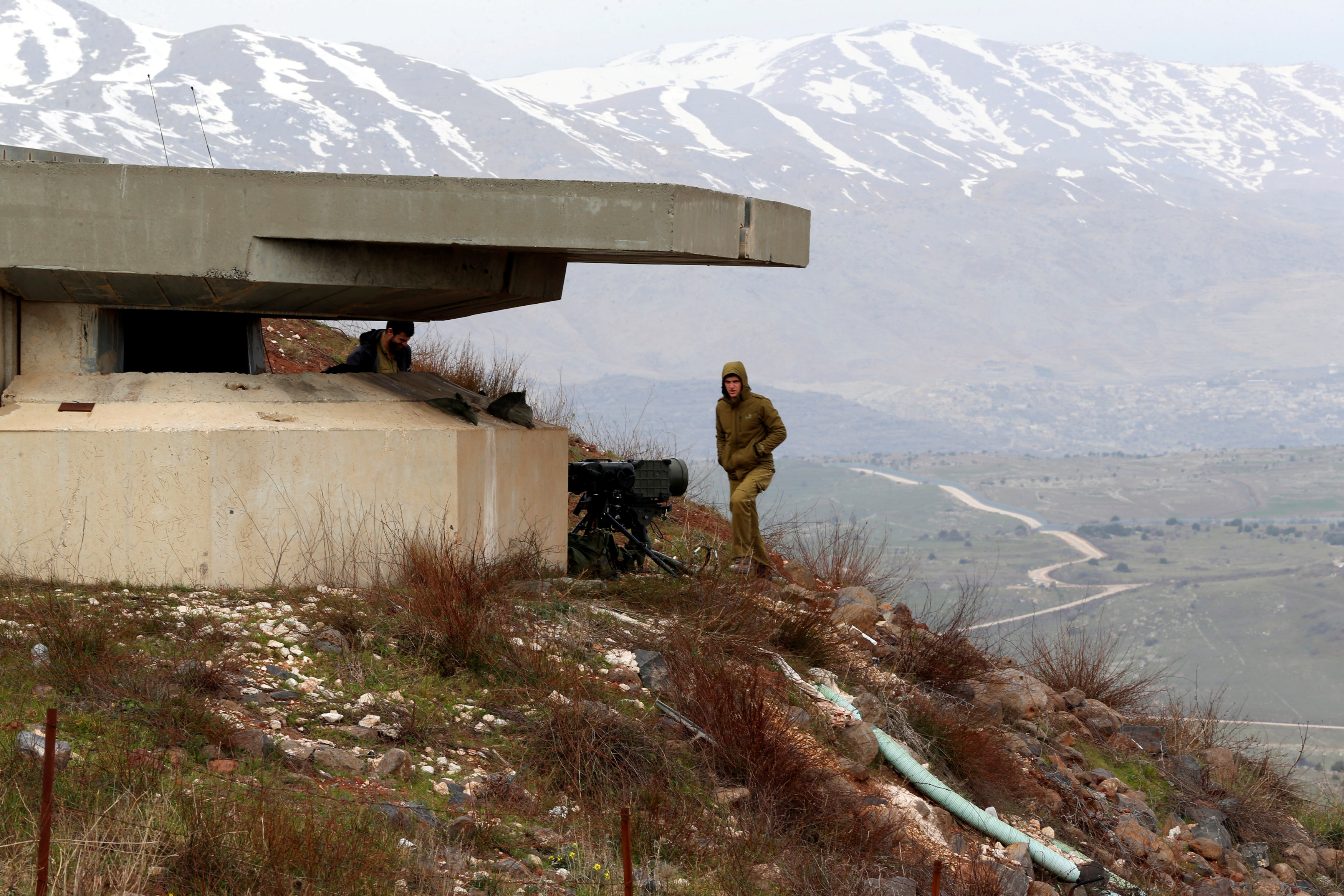 FILE PHOTO - An Israeli soldier walks near a military post close to the Druze village of Majdal Shams in the Israeli-occupied Golan Heights, Israel February 10, 2018. REUTERS/Ammar Awad/File Photo