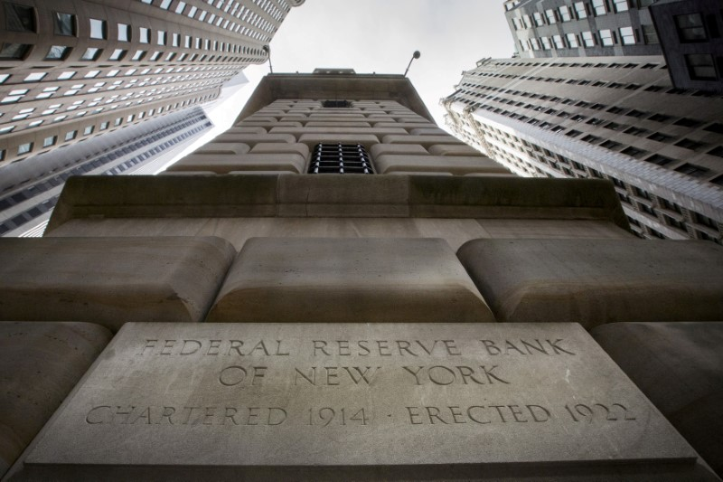 FILE PHOTO: The corner stone of the New York Federal Reserve Bank is seen surrounded by financial institutions in New York City, New York, U.S., March 25, 2015. REUTERS/Brendan McDermid/File Photo