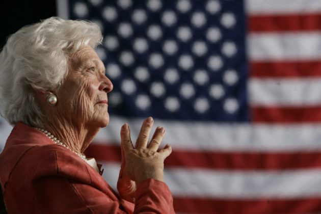 FILE PHOTO: Former U.S. first lady Barbara Bush listens to her son, President George W. Bush, as he speaks at an event on social security reform in Orlando, Florida, March 18, 2005. REUTERS/Jason Reed JIR/HB