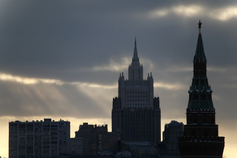 FILE PHOTO: A view shows a tower of the Kremlin (R) and the Foreign Ministry headquarters (back) in Moscow, Russia March 16, 2018. REUTERS/Maxim Shemetov/File Photo