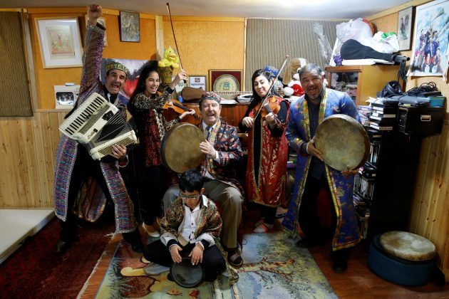 Amin Alaev (R), 55 (R), Aviva Alaev (2nd R), 22, Allo Alaev (C), 85, Amanda Alaev (2nd L), 13, Ariel Alaev (L), 51, and Avraham Alaev, 7, pose for a photograph in their rehearsal studio in Rishon Lezion, Israel March 22, 2018. REUTERS/Amir Cohen