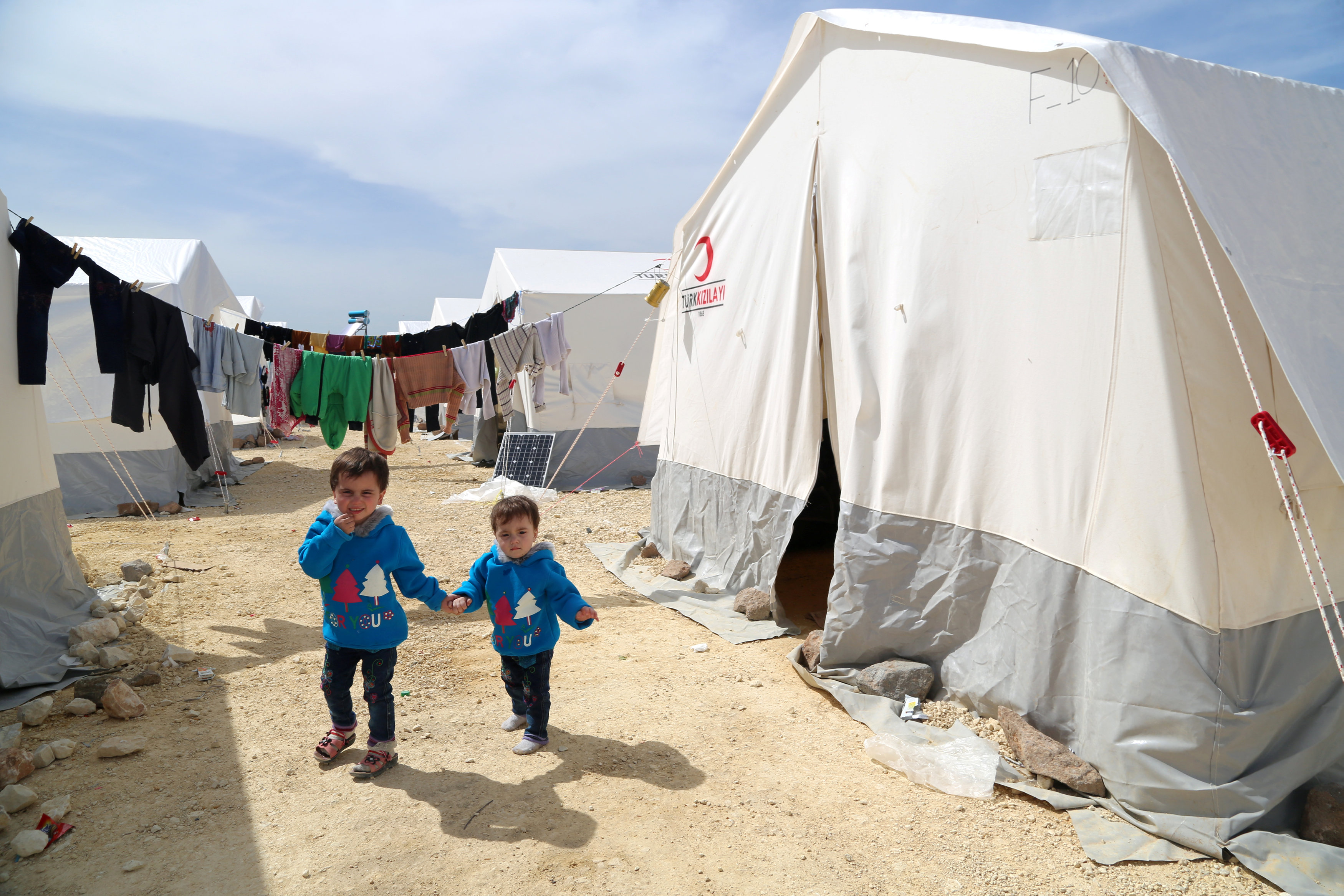 Limar and Masa al-Qari, child survivors of the suspected poison gas attack, walk outside a tent for the displaced, in the Northern Aleppo countryside, Syria April 17, 2018. Picture taken April 17, 2018. REUTERS/Mahmoud Hassano