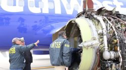 U.S. NTSB investigators are on scene examining damage to the engine of the Southwest Airlines plane in this image released from Philadelphia, Pennsylvania, U.S., April 17, 2018. NTSB/Handout via REUTERS