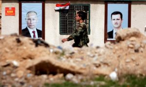 FILE PHOTO: A Syrian soldier loyal to President Bashar al Assad is seen outside eastern Ghouta, in Damascus, Syria February 28, 2018. To match Special Report RUSSIA-FLIGHTS/ REUTERS/Omar Sanadiki/File Photo