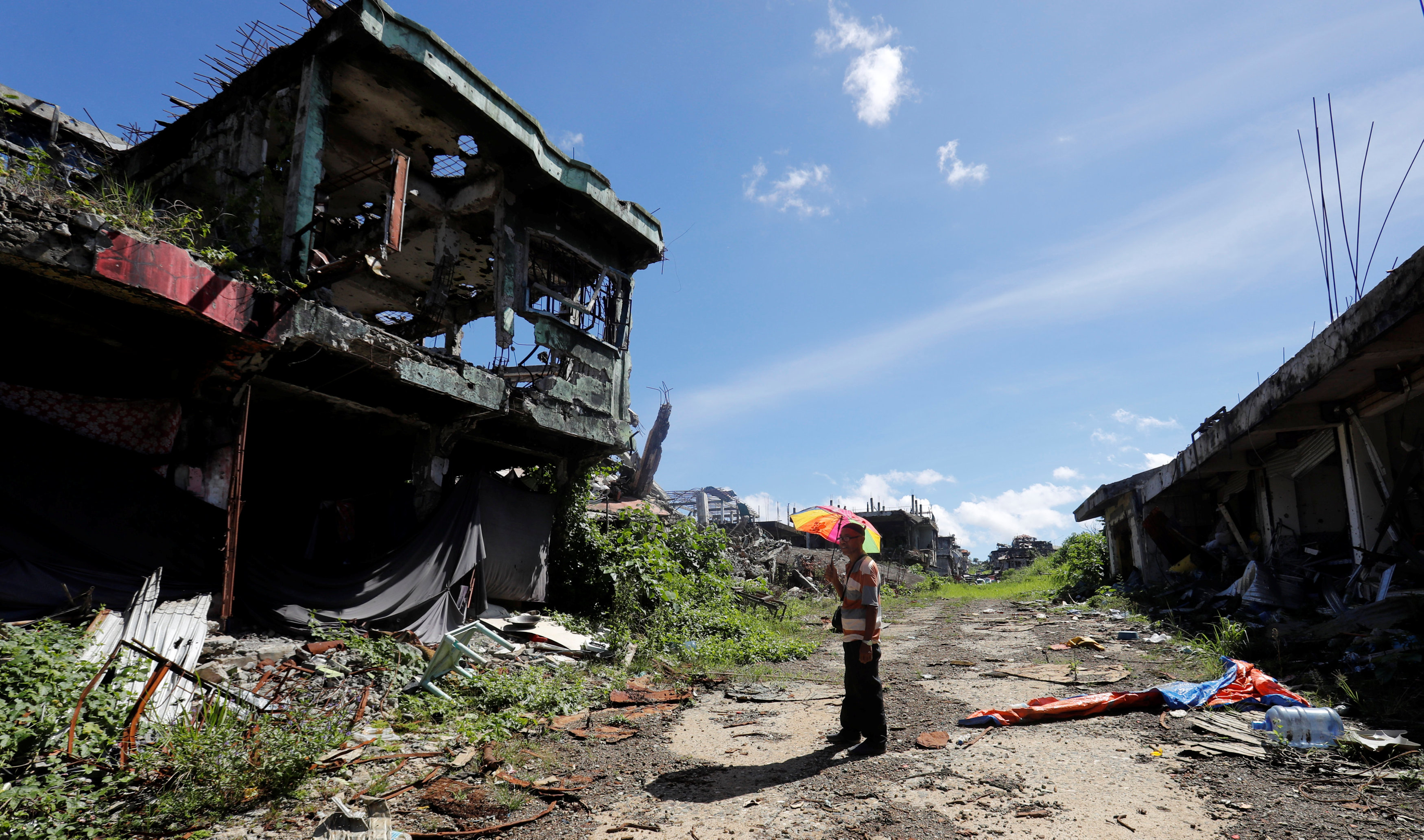 A man stands in front of his ruined house after residents were allowed to return to their homes for the first time since the battle between government troops and Islamic State militants began in May last year, in the Islamic city of Marawi, southern Philippines April 19, 2018. REUTERS/Erik De Castro