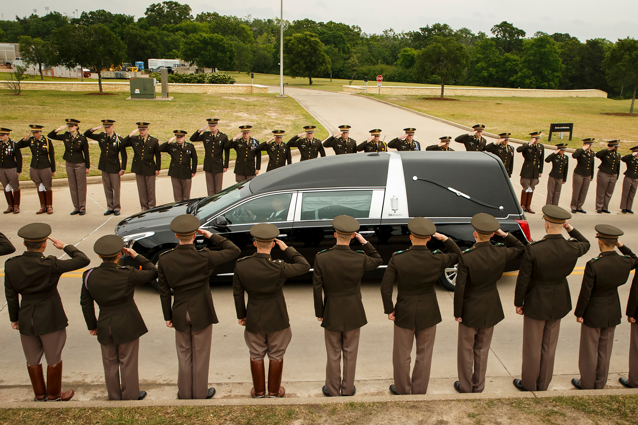 The hearse carrying former first lady Barbara Bush passes through members of the Texas A&M Corps of Cadets as it nears her husband's presidential library at the university in College Station, Texas, U.S. April 21, 2018. Smiley N. Pool/Pool via REUTERS