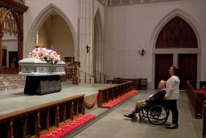 """Former U.S. President George H. W. Bush looks at the casket of his late wife, former first lady Barbara Bush with his daughter Dorothy """"Doro"""" Bush Koch during the visitation at St. Martin's Episcopal Church in Houston, Texas, U.S. April 20, 2018. Mark Burns/Office of George H.W. Bush/Pool via REUTERS"""