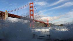 FILE PHOTO: Waves crash against a sea wall in San Francisco Bay beneath the Golden Gate Bridge in San Francisco, California, December 16, 2014. REUTERS/Robert Galbraith//File Photo