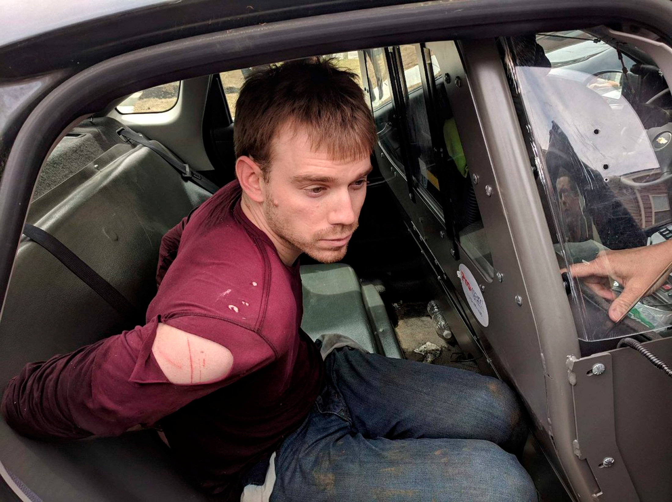 Travis Reinking, the suspect in a Waffle House shooting in Nashville, is under arrest by Metro Nashville Police Department in a wooded area in Antioch, Tennessee, U.S., April 23, 2018. Courtesy Metro Nashville Police Department/Handout via REUTERS
