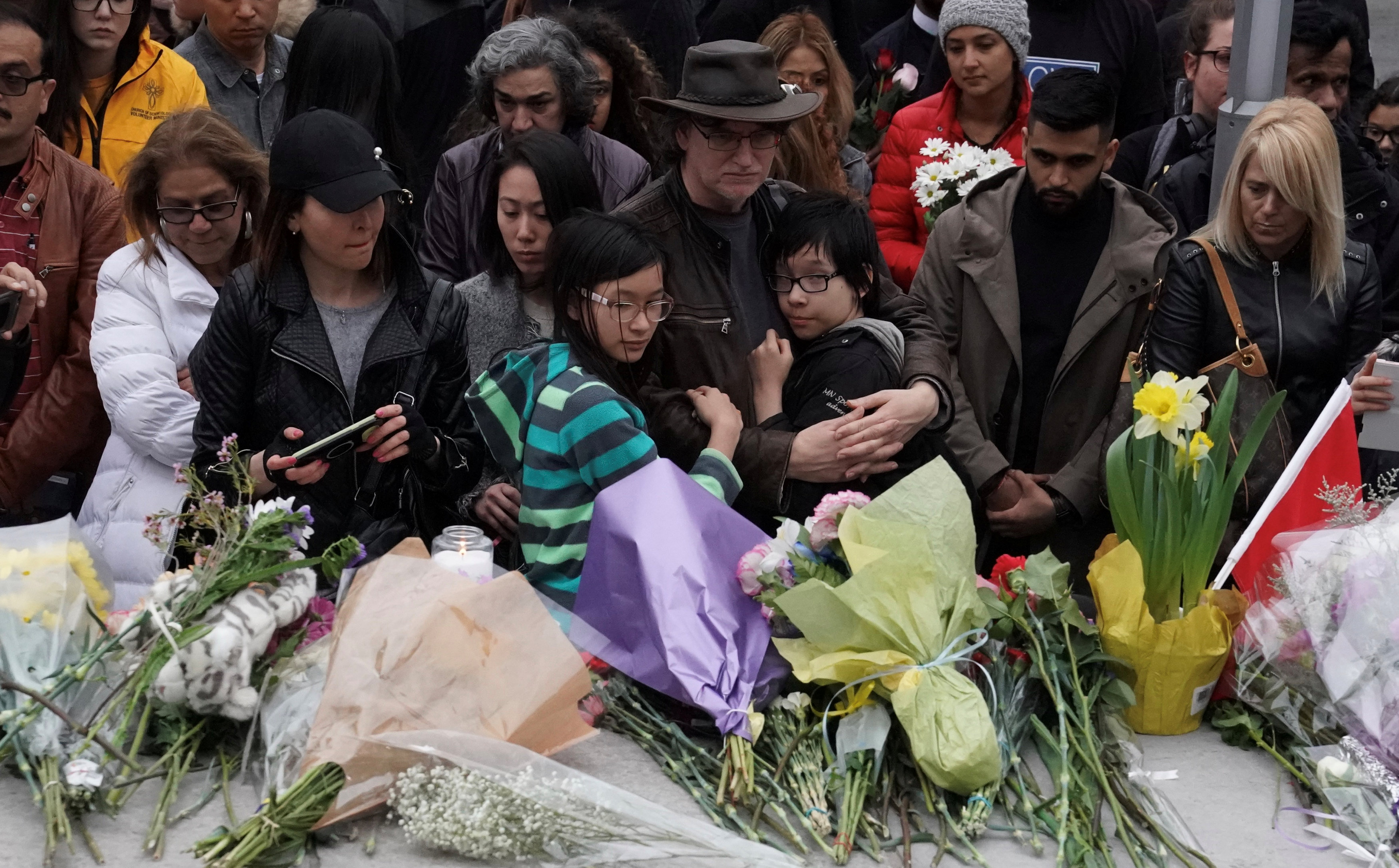 Mourners attend a makeshift memorial a day after a van struck multiple people along a major intersection in north Toronto, Ontario, Canada, April 24, 2018. REUTERS/Carlo Allegr