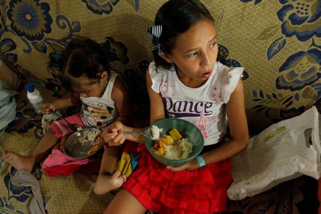 Juliani Caceres, grand daughter of Carmen Penaloza, have rice and platain for lunch at her home in San Cristobal, Venezuela April 5, 2018. Picture taken April 5, 2018. REUTERS/Carlos Eduardo Ramirez