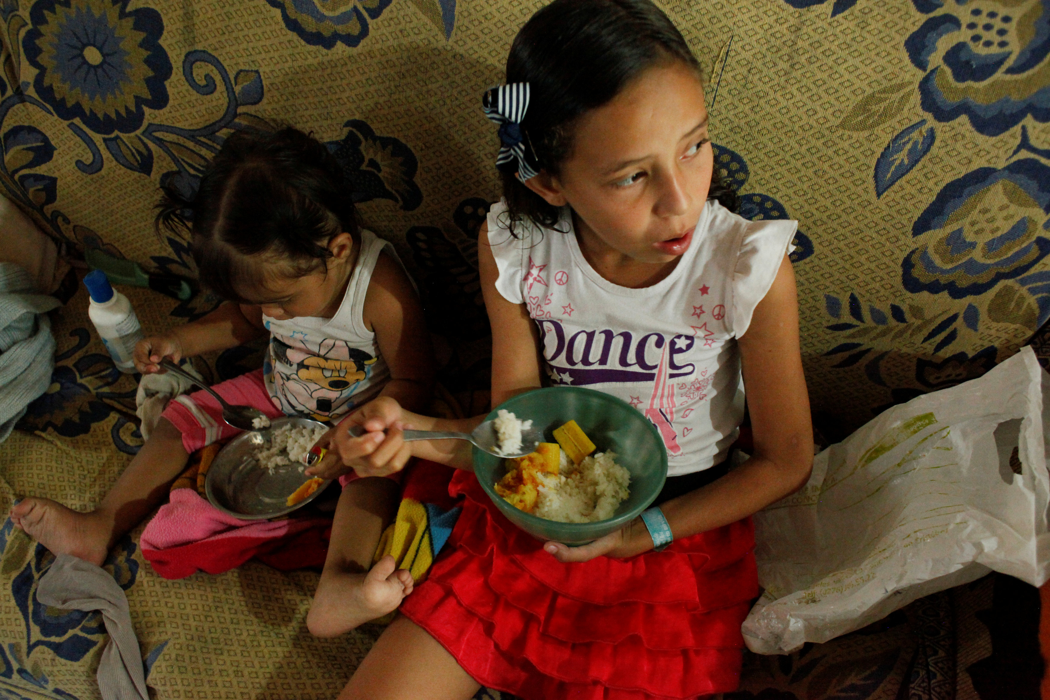 Juliani Caceres, grand daughter of Carmen Penaloza, have rice and platain for lunch at her home in San Cristobal, Venezuela April 5, 2018. Picture taken April 5, 2018. REUTERS/Carlos Eduardo Ramirez