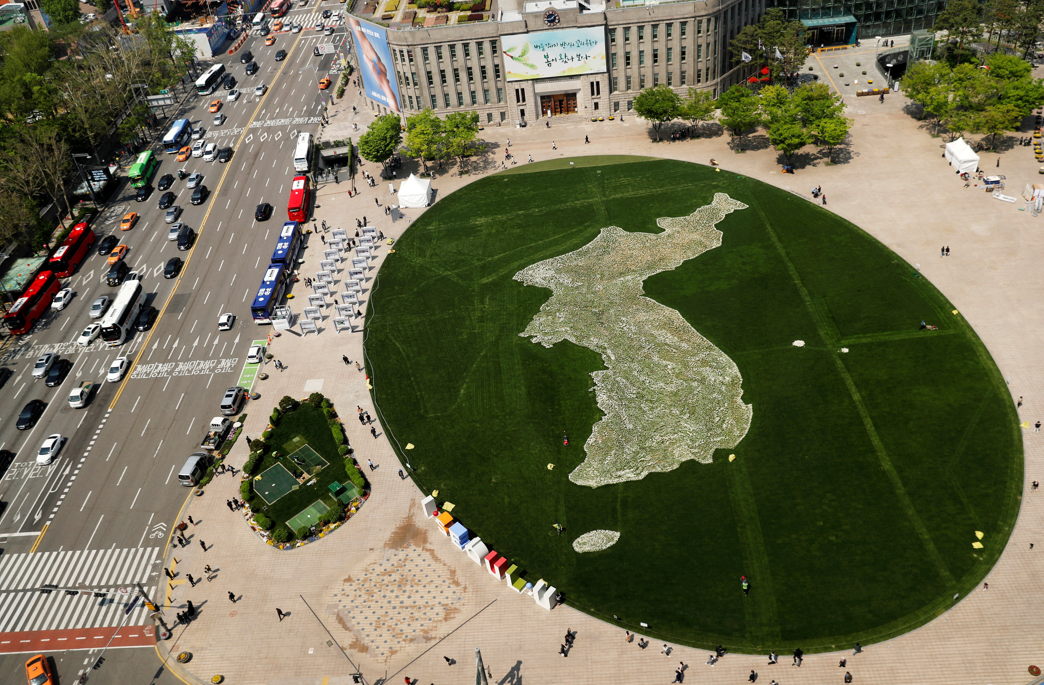 The shape of the Korean peninsula is seen on the lawn in front of City Hall ahead of the upcoming summit between North and South Korea in Seoul, South Korea April 25, 2018. REUTERS/Jorge Si