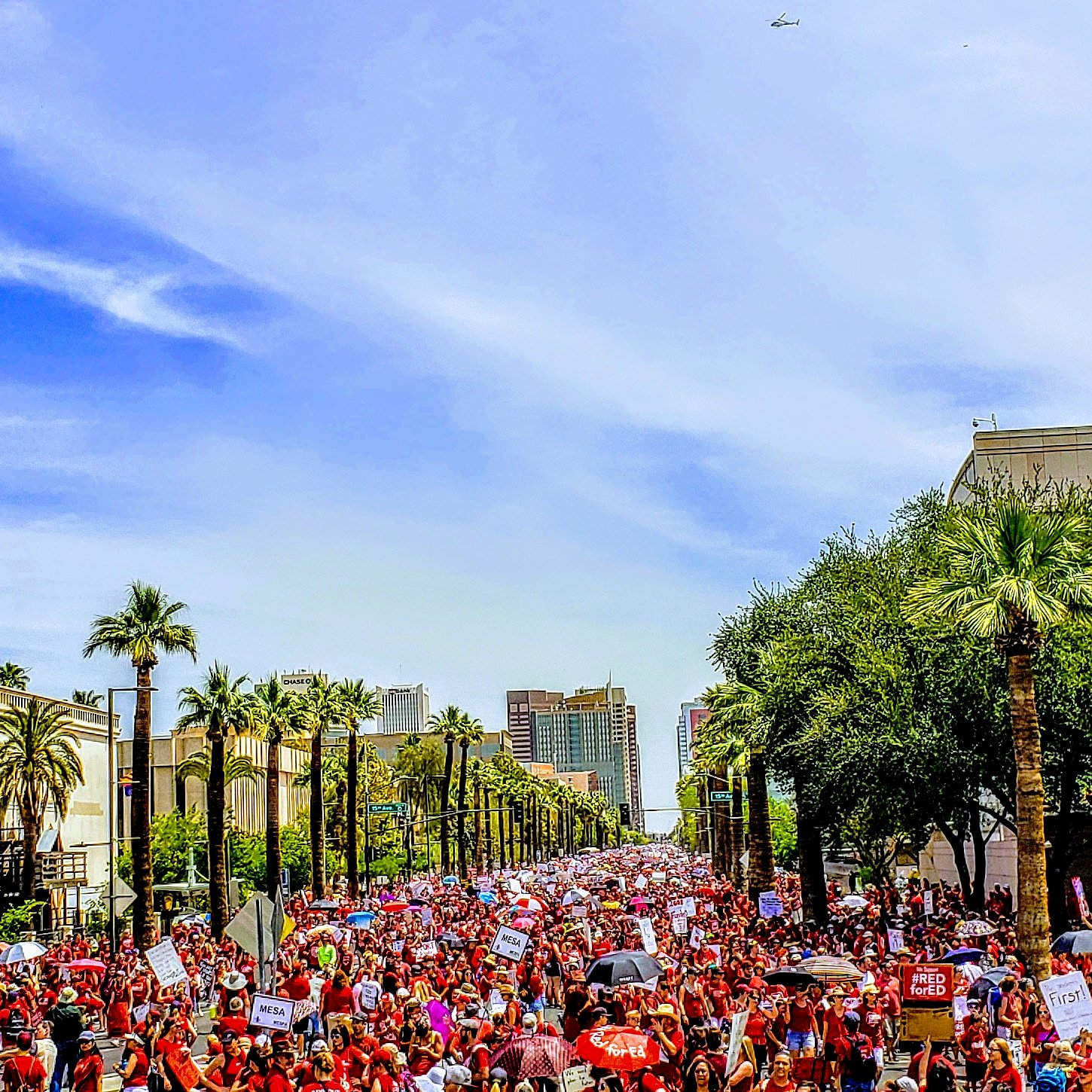 People march in front of the Capitol in Phoenix, Arizonia, U.S., April 26, 2018 in this picture obtained from social media. Jeremy Whittaker, City of Mesa Councilman/via REUTERS