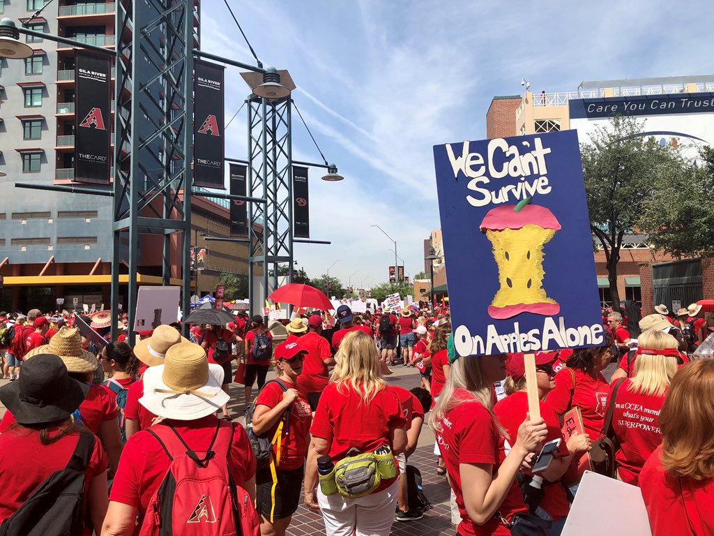 FILE PHOTO: Participants take part in a march in Phoenix, Arizona, U.S., April 26, 2018 in this picture obtained from social media. Christy Chavis/File Photo via REUTERS