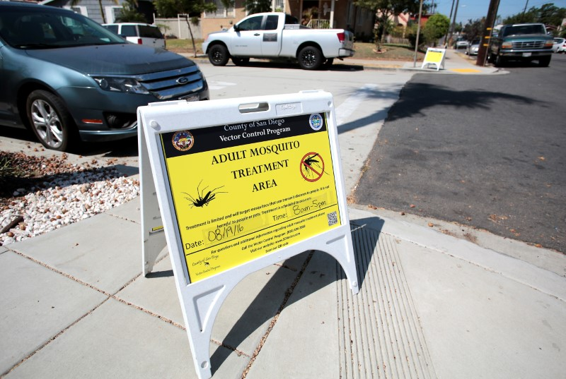 FILE PHOTO - A sign is displayed as San Diego County officials hand spray a two block area to help prevent the mosquito-borne transmission of the Zika virus in San Diego, California, U.S. August 19, 2016. REUTERS/Earnie Grafton