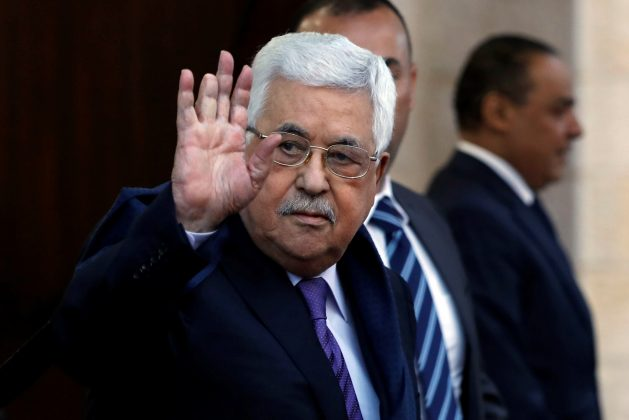FILE PHOTO: Palestinian President Mahmoud Abbas waves in Ramallah, in the occupied West Bank May 1, 2018. Picture taken May 1, 2018. REUTERS/Mohamad Torokman
