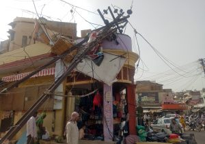 A damaged electric pole is pictured in a market after strong winds and dust storm in Alwar, in the western state of Rajasthan, India May 3, 2018. REUTERS/Stringer