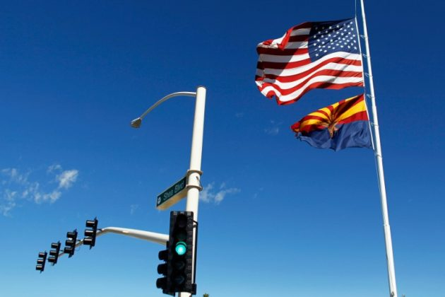 The U.S. and Arizona flags flutter in the wind in Fountain Hills, Arizona, U.S. on September 30, 2016. REUTERS/Ricardo Arduengo
