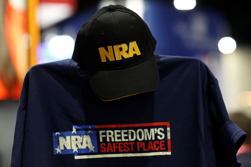 A cap and shirt are displayed at the booth for the National Rifle Association (NRA) at the Conservative Political Action Conference (CPAC) at National Harbor, Maryland, U.S., February 23, 2018. REUTERS/Joshua Roberts