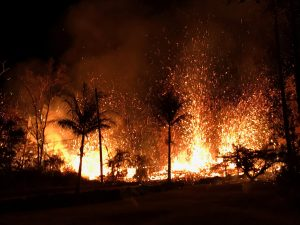 A new fissure spraying lava fountains as high as about 230 feet (70 m), according to United States Geological Survey, is shown from Luana Street in Leilani Estates subdivision on Kilauea Volcano's lower East Rift Zone in Hawaii, U.S., May 5, 2018. US Geological Survey/Handout via REUTERS
