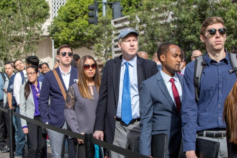 FILE PHOTO: Job seekers line up at TechFair in Los Angeles, California, U.S. March 8, 2018. REUTERS/Monica Almeida/File Photo