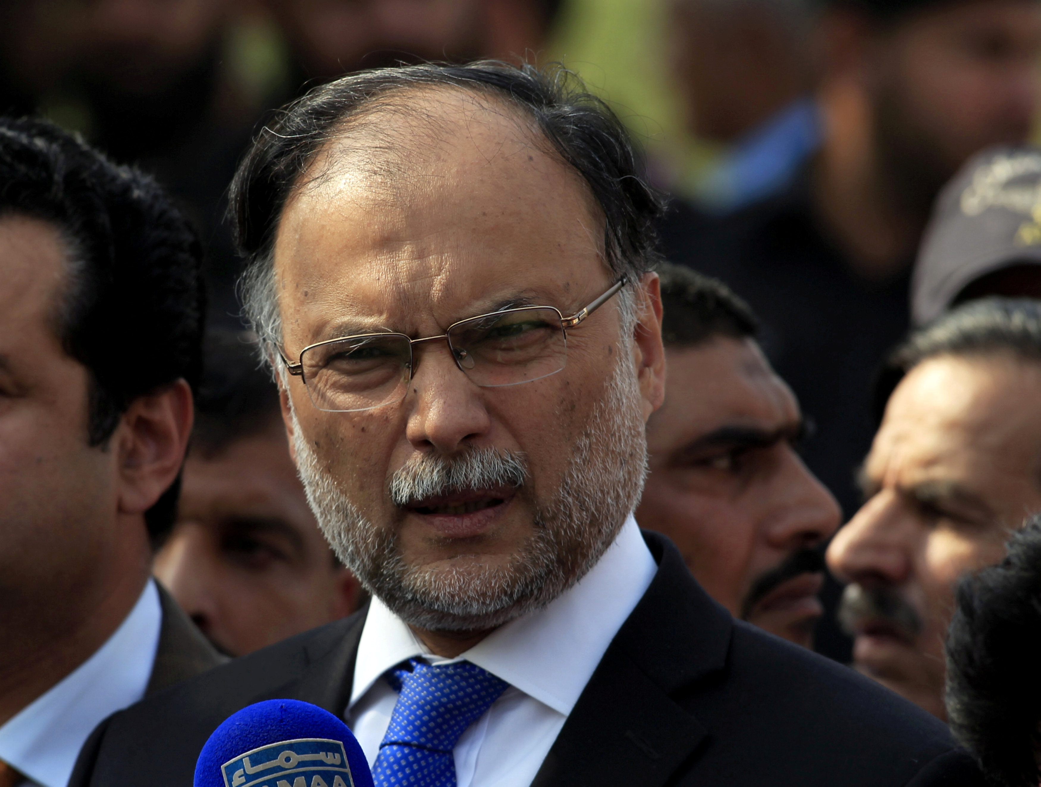 FILE PHOTO: Pakistan's Interior Minister Ahsan Iqbal speaks to media outside the accountability court in Islamabad, Pakistan October 2, 2017. REUTERS/Faisal Mahmood/File Photo