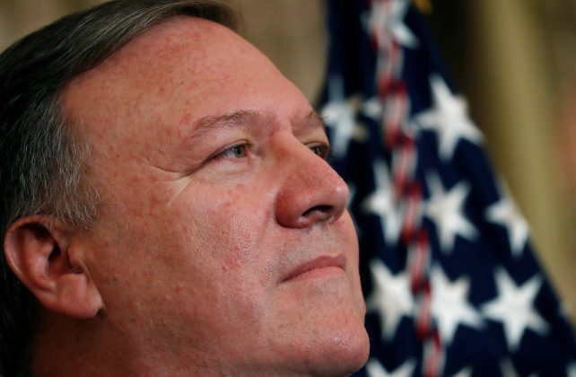 FILE PHOTO: U.S. Secretary of State Mike Pompeo listens to remarks made by President Donald Trump during Pompeo's swearing-in ceremony at the Department of State in Washington, U.S., May 2, 2018. REUTERS/Leah Millis