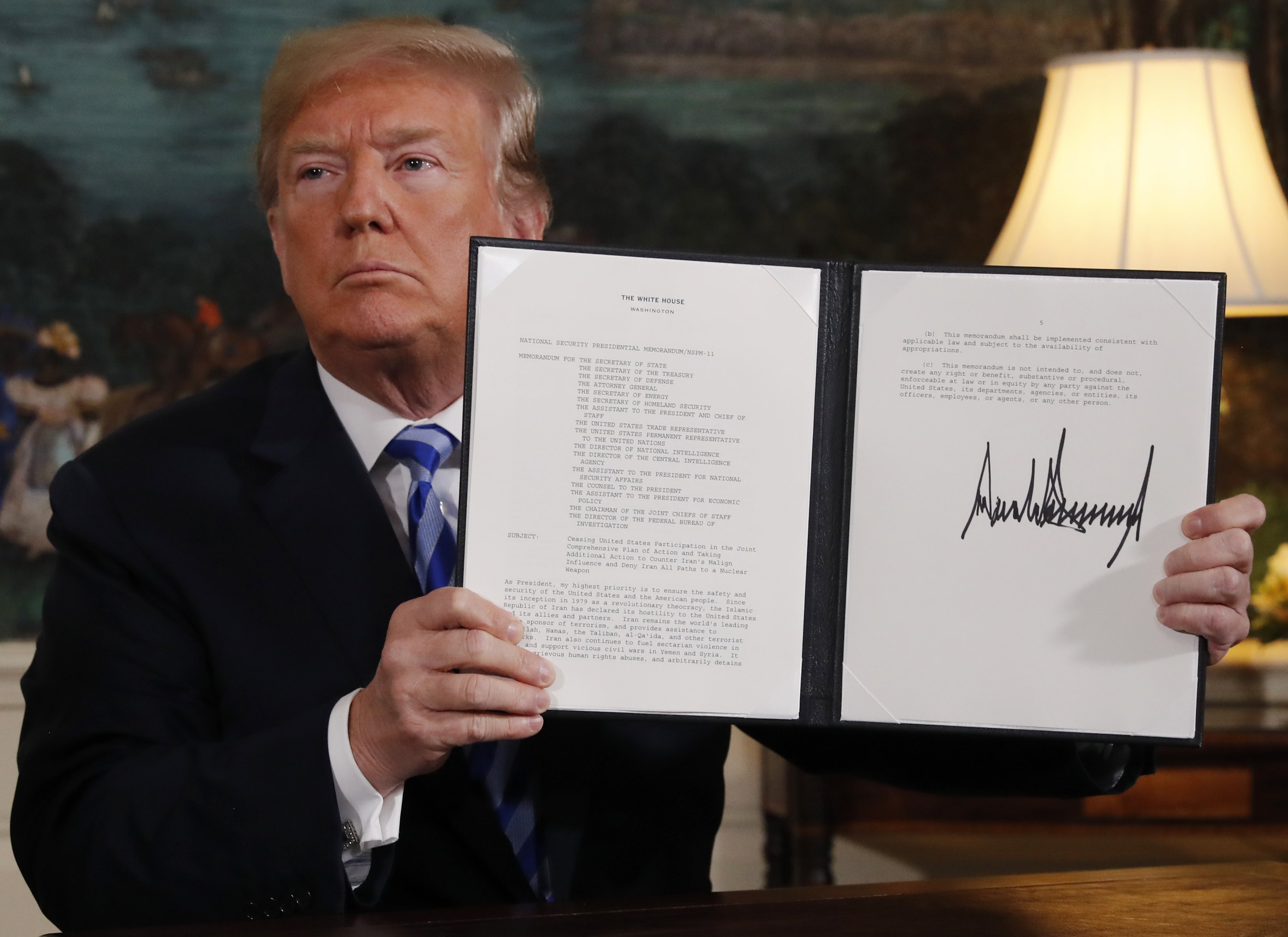 U.S. President Donald Trump displays a presidential memorandum after announcing his intent to withdraw from the JCPOA Iran nuclear agreement in the Diplomatic Room at the White House in Washington, U.S., May 8, 2018. REUTERS/Jonathan Ernst