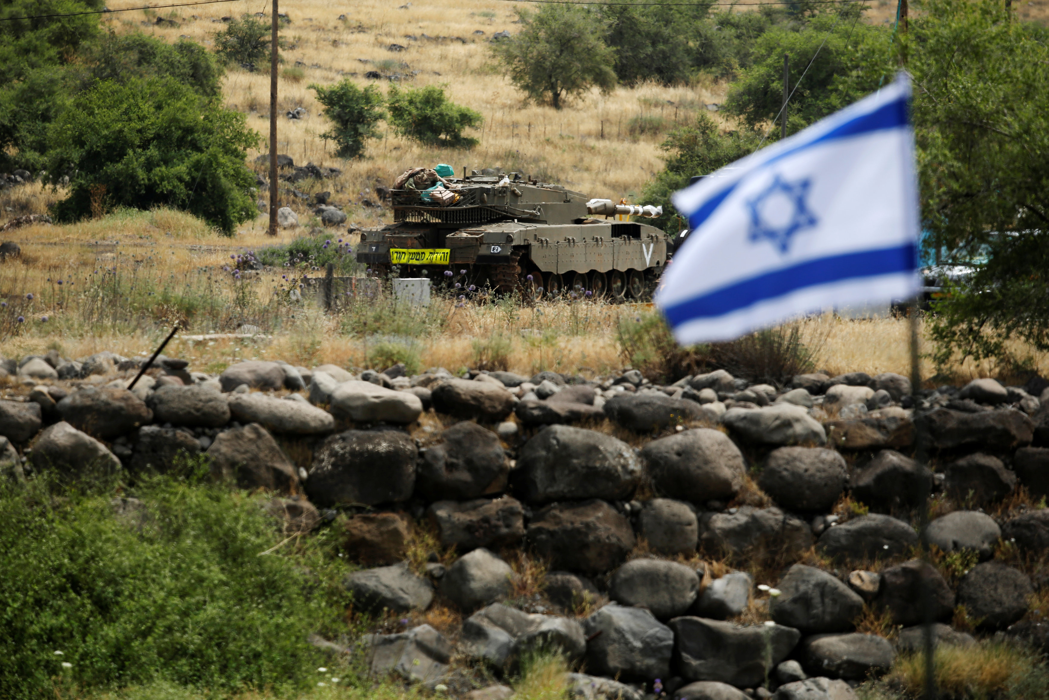 An Israeli tank can be seen near the Israeli side of the border with Syria in the Israeli-occupied Golan Heights, Israel May 9, 2018. REUTERS/Amir Cohen