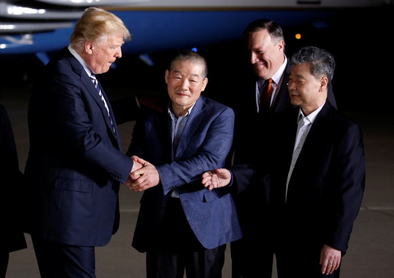 U.S.President Donald Trump greets the Americans formerly held hostage in North Korea upon their arrival at Joint Base Andrews, Maryland, U.S., May 10, 2018. REUTERS/Joshua Roberts
