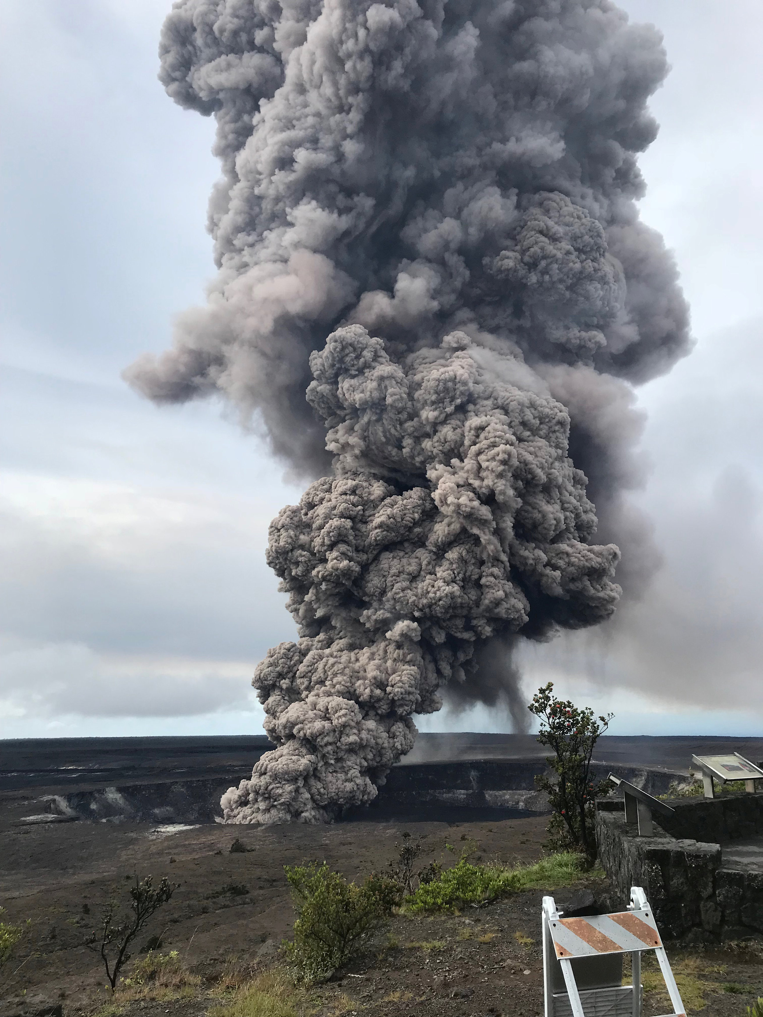An ash column rises from the Overlook crater at the summit of Kilauea Volcano in Hawaii, May 9, 2018. USGS/Handout via REUTERS