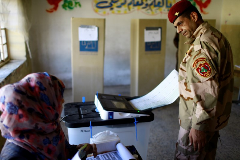 An Iraqi security member casts his vote at a polling station two days before polls open to the public in a parliamentary election in Baghdad, Iraq May 10, 2018. REUTERS/Thaier al-Sudani