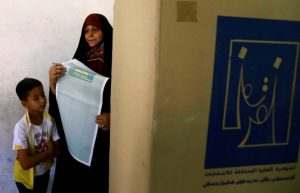 A female security member casts her vote at a polling station two days before polls open to the public in a parliamentary election in Baghdad, Iraq May 10, 2018. REUTERS/Thaier al-Sudani
