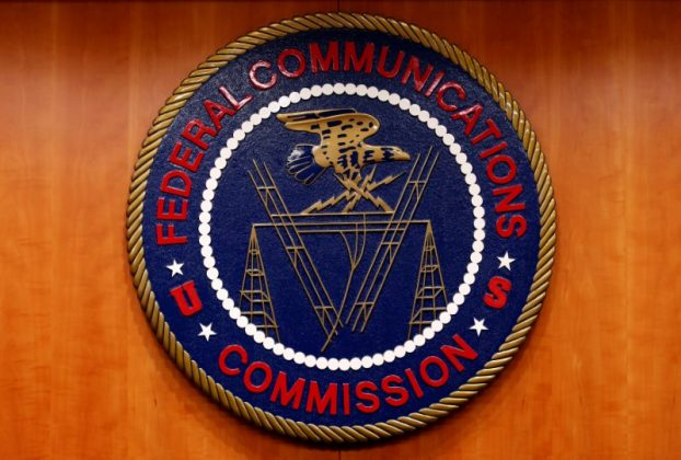 FILE PHOTO: The Federal Communications Commission (FCC) logo is seen before the FCC Net Neutrality hearing in Washington, U.S., February 26, 2015. REUTERS/Yuri Gripas/File Photo