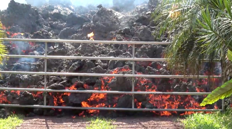 Lava advances towards a metal barrier in Puna, May 6, 2018. WXCHASING via REUTERS
